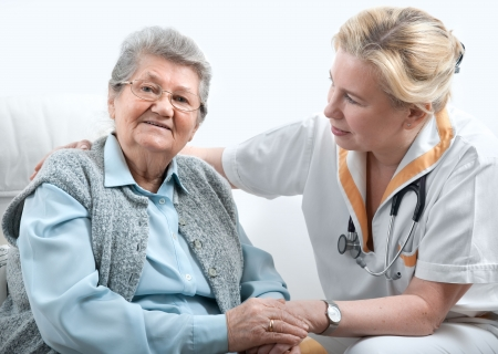 health care worker and senior patient  photo