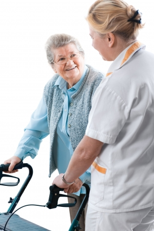 health care worker and senior patient with a walker photo