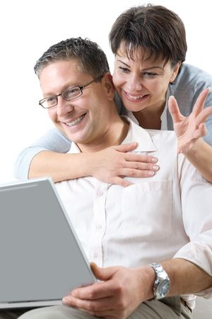 happy couple using laptop photo