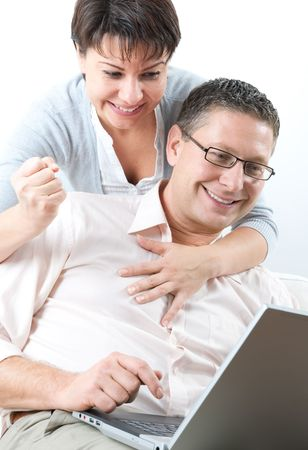 happy couple using laptop photo