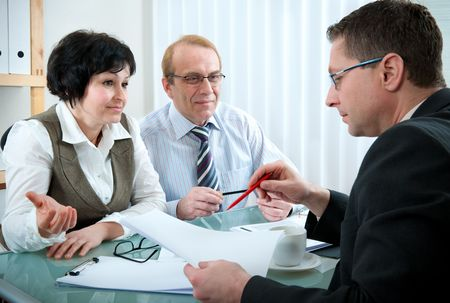 insurance consultant: Senior couple meeting with agent Stock Photo