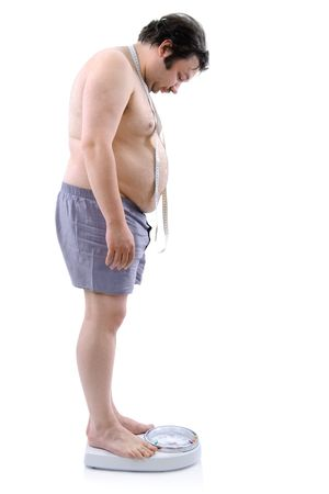 Overweight man with the weight scale Stock Photo - 6315779