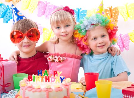 party pastries: kids celebrating birthday party  Stock Photo