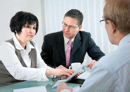 woman and her lawyer in conversation with husband during divorce process Stock Photo - 6790874