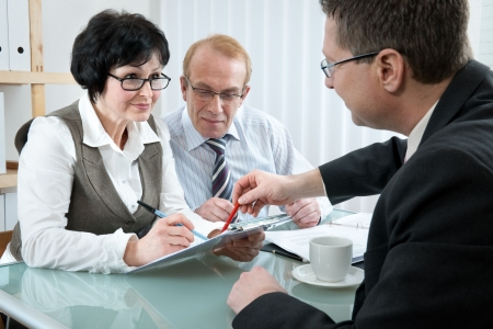 insurance consultant: Senior couple meeting with agent or advisor