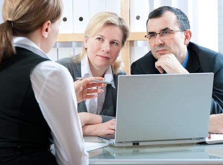 mid adult couple meeting with agent or advisor photo
