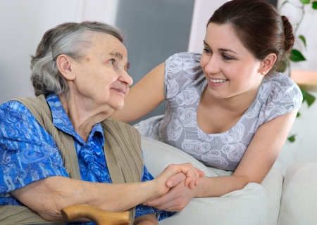 care at home: Senior woman with her home caregiver Stock Photo