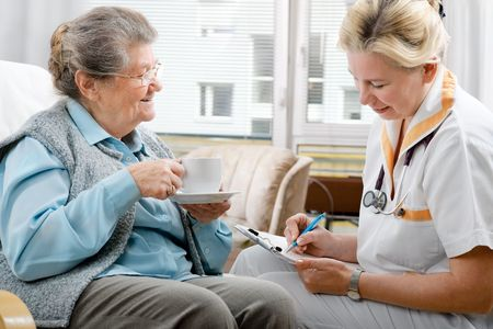 nursing service: Senior woman is visited by her doctor or caregiver