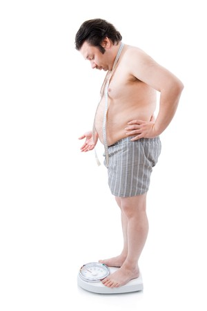 fatty: Overweight man on the weight scale Stock Photo