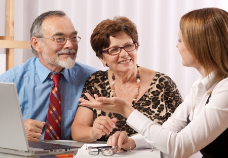 a marriage meeting: Senior couple meeting with agent or advisor