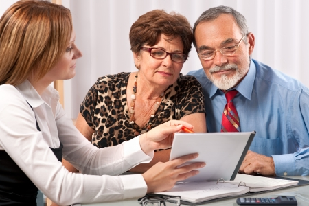financial advice: Senior couple meeting with agent or advisor