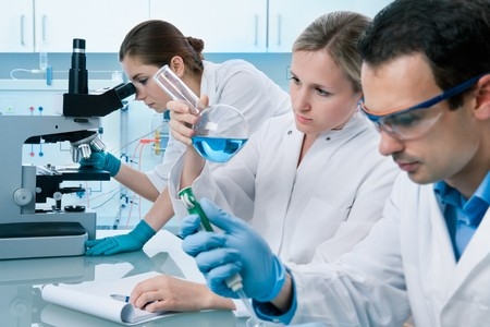 group of scientists working at the laboratory Stock Photo - 7908031