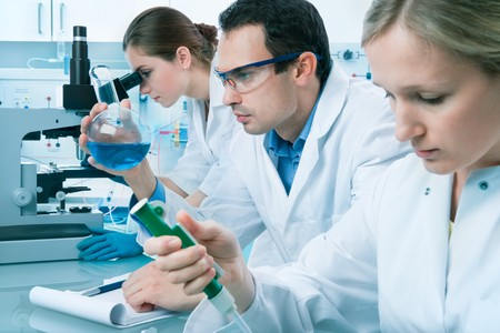group of scientists working at the laboratory Stock Photo - 7908032