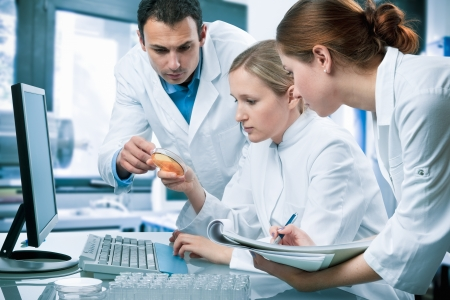 group of scientists working at the laboratory Stock Photo - 7908037