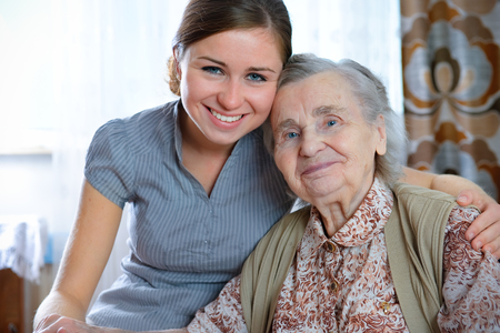 seniors homes: Senior woman with her home caregiver Stock Photo