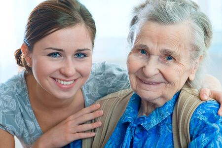home care: Senior woman with her home caregiver Stock Photo