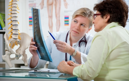 Doctor explaining x-ray results to patient Stock Photo