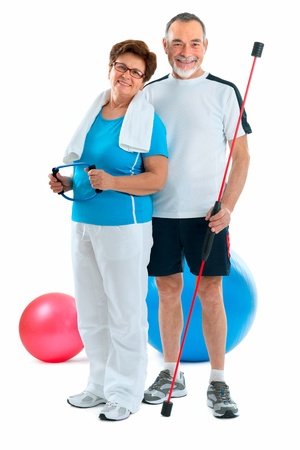 Smiling elderly couple working out in gym photo