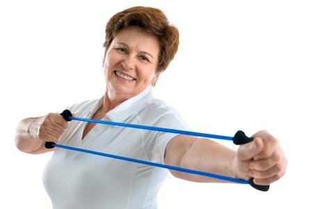 senior exercising: Senior woman using a resistance band