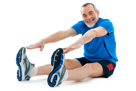 senior man doing warm-up exercises. Isolated on white photo