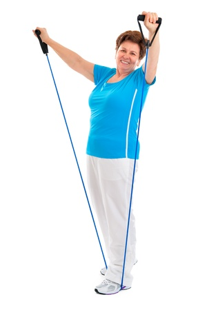 senior woman doing exercises with a resistance band Stock Photo