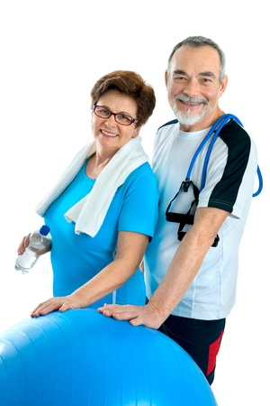 senior fitness: Smiling elderly couple working out in gym. Isolated on white