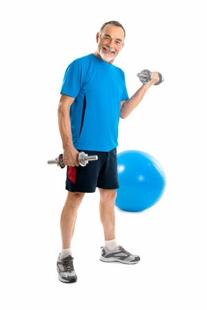 keep fit: senior man lifting weights during gym workout  Stock Photo