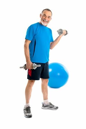 senior health: senior man lifting weights during gym workout  Stock Photo