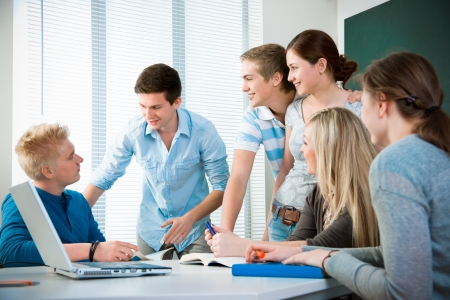 young students studying together in a classroom Stock Photo - 9318670