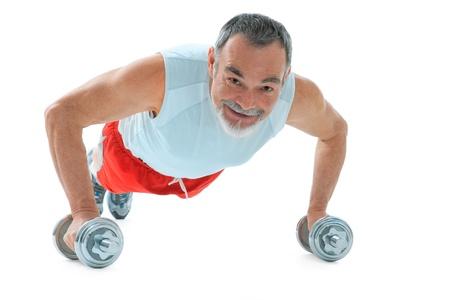 1 mature man: senior man  doing push-ups exercise in gym Stock Photo