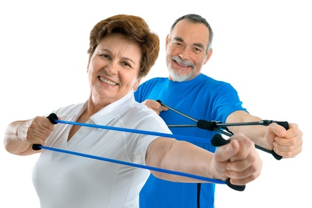 strength therapy: couple of active seniors  doing exercises with a resistance band