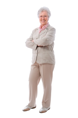 Happy senior woman standing  with her arms crossed Stock Photo