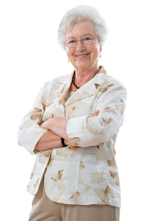 Happy senior woman standing with her arms crossed  and smiling at the camera Stock Photo - 9626238