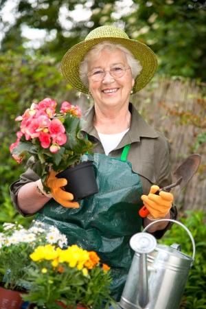 Portrait of a attractive senior woman gardening