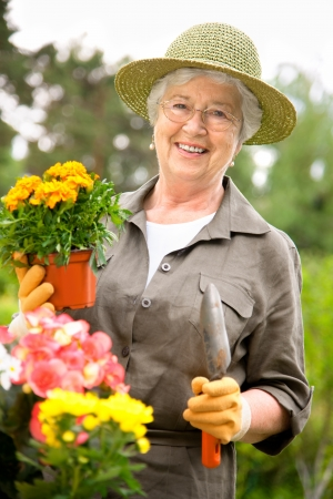 Portrait of a attractive senior woman gardening photo