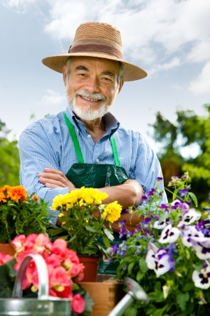 Portrait of a attractive senior man gardening photo