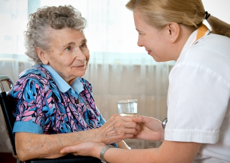 Senior woman with her home caregiver Stock Photo - 9971020