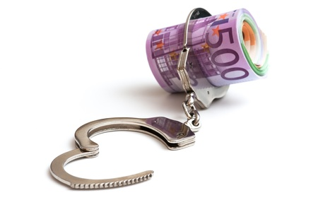 tax evasion: Euro notes with a pair of handcuffs  Stock Photo