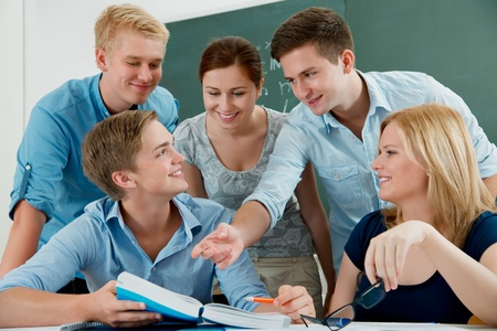 group of students studying together in a classroom Stock Photo - 10410964
