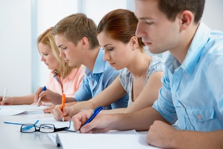 college student during an exam in a classroom photo