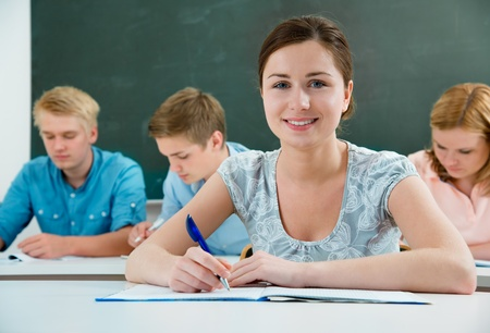 student studying: group of students  while studying in classroom Stock Photo