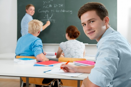university classroom: group of students  while studying in classroom Stock Photo