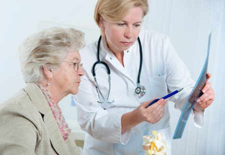 general practitioner: Doctor and patient discussing scan results in diagnostic center