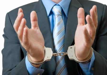 corrupcion: Delitos de cuello blanco bajo arresto Foto de archivo