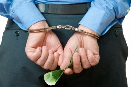 White collar criminal under arrest photo