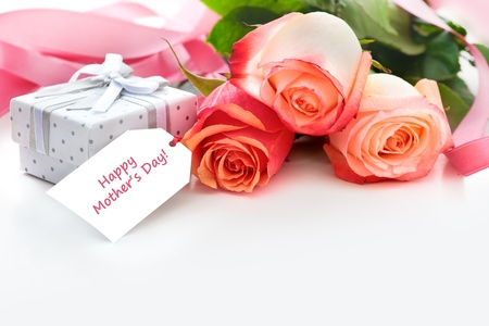 Bouquet of roses and gift box with a mother Stock Photo - 10952122