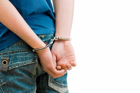 Young man in handcuffs photo