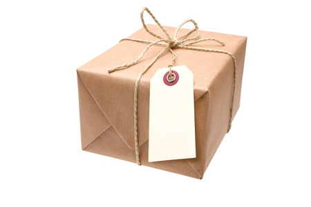 package: brown paper parcel with a blank luggage tag Stock Photo
