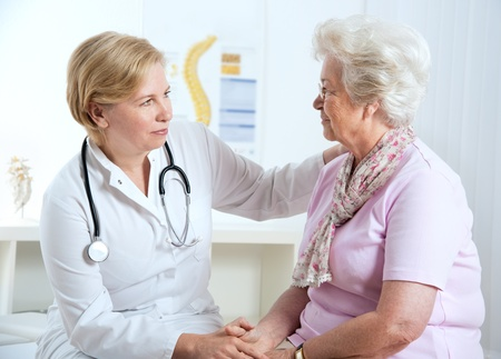 female doctor explaining diagnosis to her female patient  photo