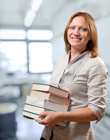 teacher or student holds the books  photo